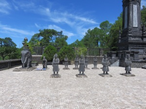 The tombs were guarded by mandarin statues,  all about the same height as Ken and Linda.