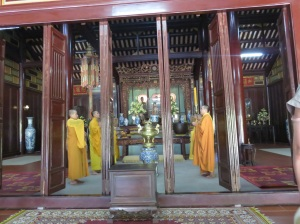 Buddhist monks chanting. What a great religion that promotes peace and kindness, and even better that people but cans of beer at the shrines for the spirits!